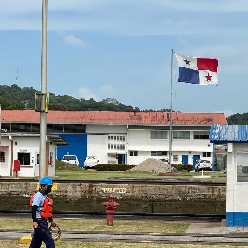 Line handlers walking on the edge of the Panama Canal