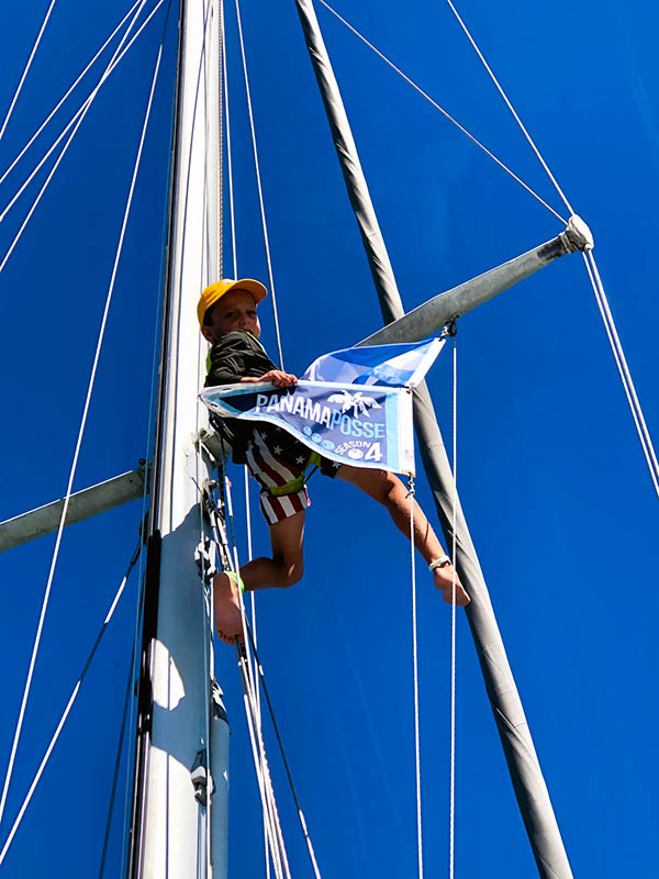 Here's a picture of our 6-year-old, Magnus, aloft making sure the Panama Posse burgee is flying properly in Bahia del Sol, El Salvador.