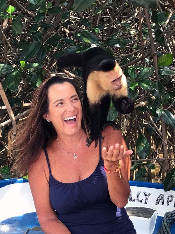 🇨🇷 PANAMA POSSE SEASON 1 - Christine and a freindly Capuchin monkey at Manuela Antonio NP SY SUGAR SHACK currently at  23 08.567' S 135 01.464 W