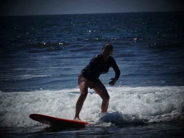 surf instructor. $35 per 2-hour session for the two of us, including transportation and boards.