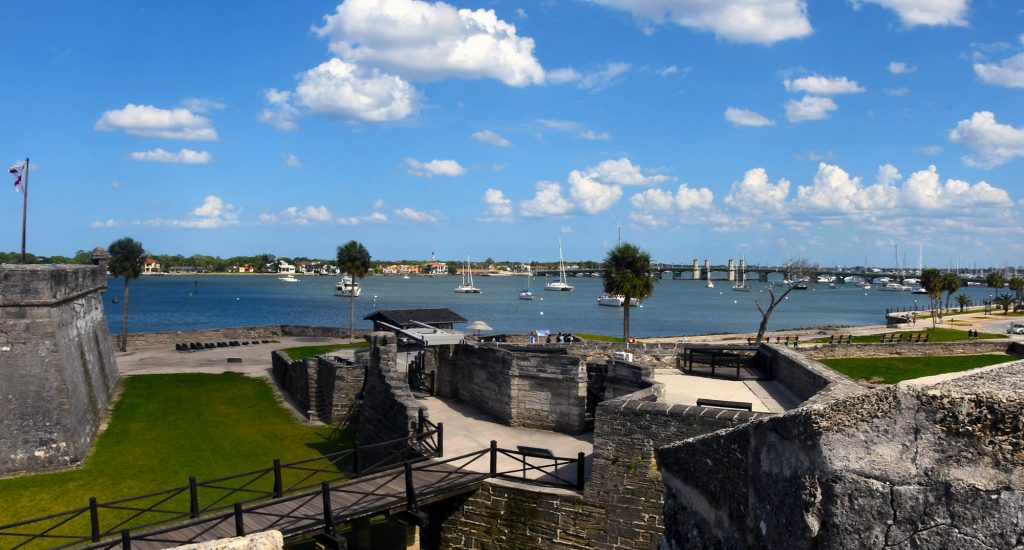 After attempting unsuccessfully to board the French ships anchored there, Menendez sailed to a harbor farther south and estab-lished St. Augustine as a base for further operations. Almost immediately a French fleet sailed south to attack. But the ships were driven southward and wrecked by a violent storm and the mission failed. Re-alizing that Fort Caroline would be lightly guarded, the Spaniards marched north, captured the fort, and executed most of the inhabitants. The same fate befell survi-vors from the French fleet, whom the Span- iards captured and killed at an inlet 14 miles south of St. Augustine.